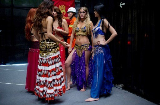Miss World contestants wait backstage prior to a rehearsal for the final ceremony at the Ordos Stadium Arena in the inner Mongolian city of Ordos on August 17, 2012. More than 100 beauty queens from a