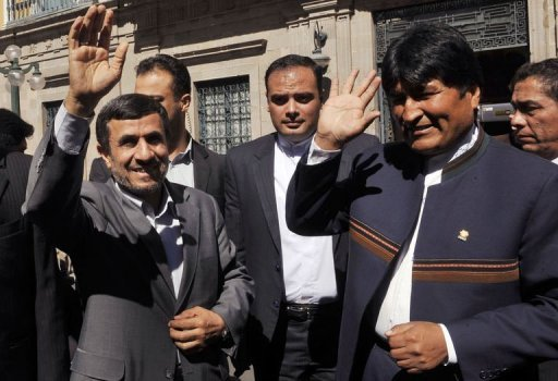 Bolivian President Evo Morales (R) and Iranian President Mahmud Ahmadinejad wave to the crowd at the Plaza de Armas square before going to the presidential house to meet in La Paz. Ahmadinejad arrived in Bolivia for a brief visit with Morales Tuesday, before continuing on to Brazil for the UN summit on sustainable development