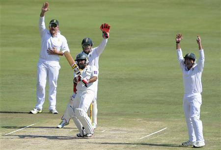 South African players Smith, de Villiers and Elgar appeal unsuccessfully for the wicket of Pakistan's Ahmed during the third day of the third cricket Test match in Pretoria