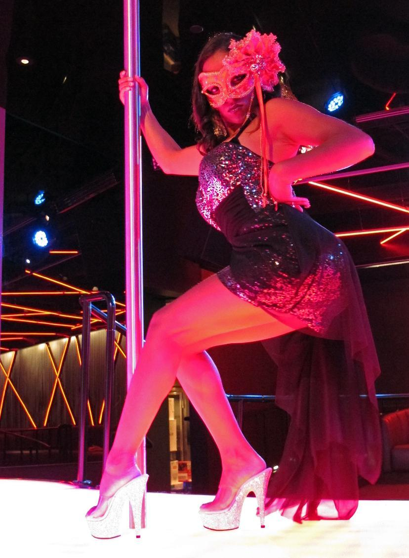 A dancer at Scores rehearses on Monday, Aug. 26, 2013 for the strip club's opening inside the Taj Mahal Casino Resort in Atlantic City, N.J. next month. It will mark the first time in 35 years of legalized gambling in New Jersey that a strip club has opened within a casino. (AP Photo/Wayne Parry)