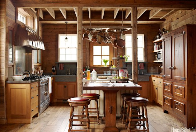 "<a target=""_blank"" href=""http://www.housebeautiful.com/kitchens/dream/before-after-kitchen-makeover-photos-1211?link=emb&dom=yah_home&src=syn&mag=hbu#slide-1"">Designer Mick De Giulio</a> turned a former stable into this sophisticated farmhouse-style kitchen."