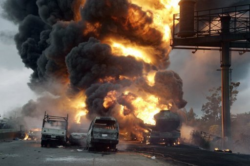 "<p>File picture of a petrol tanker blaze at Ibafo Town on the Lagos to Ibadan highway in 2010. Dozens of people who rushed to scoop up fuel after a petrol tanker tipped over were ""caught in the blaze"" when the vehicle caught fire, Nigerian military and police spokesmen said on Thursday.</p>"