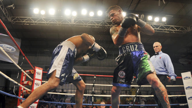 "In this photo taken Feb. 10, 2012 and provided by Event Marketing & Communications, boxer Orlando Cruz, right, battles Alejandro Delgado during a fight at the Palm Bay Community Center in Palm Bay, Fla. Describing himself as ""a proud gay man,"" Puerto Rican featherweight Orlando Cruz on Thursday, Oct. 4, 2012, became what is believed to be the first pro boxer to come out as openly homosexual while still competing. (AP Photo/Event Marketing & Communications, Reynaldo Sanchez)"