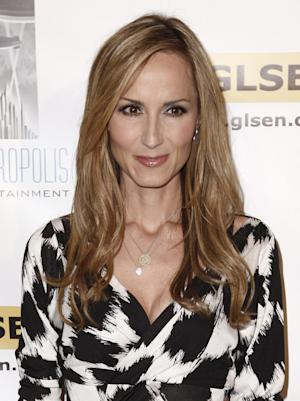 FILE - In this Oct. 8, 2010 file photo, musician Chely Wright arrives at the Gay, Lesbian, and Straight Education Network's Respect Awards in Beverly Hills, Calif.  When Wright came out as a lesbian, radio stations stopped playing her songs, record sales dropped and venues stopped booking her. Now two years later, Wright  is seeking to help others facing challenges because of their sexual orientation through LIKEME Lighthouse, a community center opening this weekend in Kansas City, Mo. (AP Photo/Matt Sayles, file)