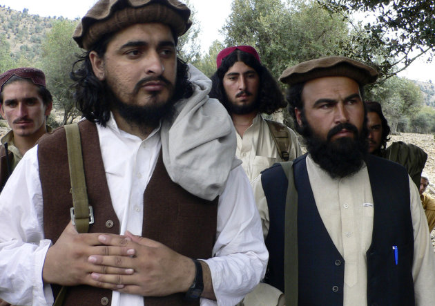 FILE - In this Oct. 4, 2009 file photo, Pakistani Taliban chief Hakimullah Mehsud, left, is seen with his comrade Waliur Rehman during his meeting with media in Sararogha, a Pakistani tribal area of South Waziristan along the Afghanistan border. Pakistan's leading militants have called on fighters to honor an agreement not to attack the Pakistani military in the most important sanctuary for the Taliban and al-Qaida along the Afghan border.