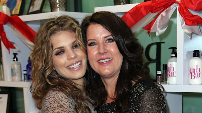 Celebrity makeup artist and Bath Bar founder Kristina Vogel, right, and actress AnnaLynne McCord pose together at the Bath Bar by Kristina Vogel Flagship Store Grand Opening launch party on Saturday, Dec. 1, 2012, in Hermosa Beach, Calif. (Photo by Matt Sayles/Invision for BathBar.com/AP Images)
