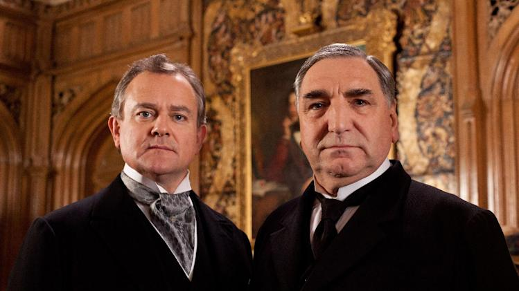 "FILE - This undated file publicity image provided by PBS shows Hugh Bonneville as Lord Grantham, left, and Jim Carter as Mr. Carson from the popular series ""Downton Abbey."" The fourth season of ""Downton Abbey"" will debut Sunday, Jan 5, 2014. (AP Photo/PBS, Josh Barratt)"