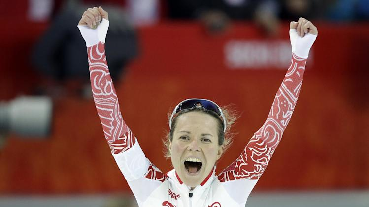 Russia's Olga Graf celebrates her time after competing in the women's 3,000-meter speedskating race at the Adler Arena Skating Center during the 2014 Winter Olympics, Sunday, Feb. 9, 2014, in Sochi, Russia. (AP Photo/Patrick Semansky)