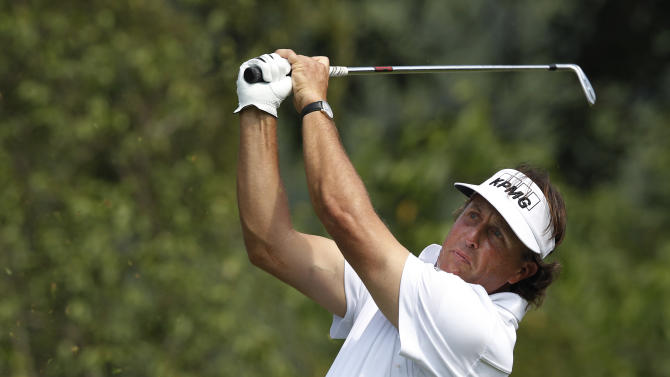 Phil Mickelson from the U.S. tees off on the 6th hole during the third round of the HSBC Champions golf tournament in Dongguan, southern China's Guangdong province, Saturday, Nov. 3, 2012. (AP Photo/Kin Cheung)