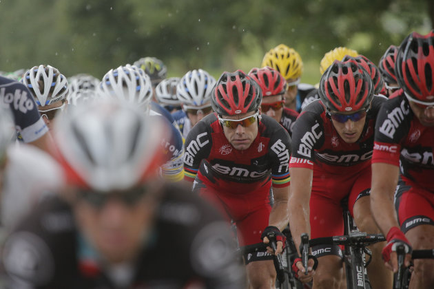 Cadel Evans of Australia, 2011 Tour de France winner, third from right, rides in the pack during the sixth stage of the Tour de France cycling race over 207.5 kilometers (129 miles) with start in Eper