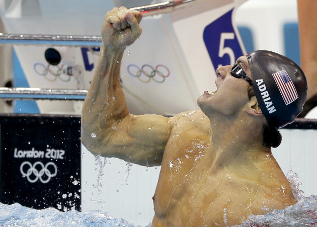 United States' Nathan Adrian celebrates his gold medal win in the men's 100-meter freestyle swimming final at the Aquatics Centre in the Olympic Park during the 2012 Summer Olympics in London, Wednesd