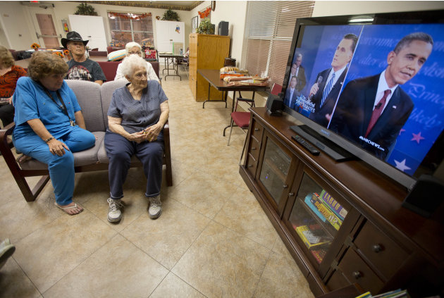 Residents of the Quail Ridge Manor independent living apartment complex watch the presidential debate, Tuesday, Oct. 16, 2012, in Boulder City, Nev. (AP Photo/Julie Jacobson)