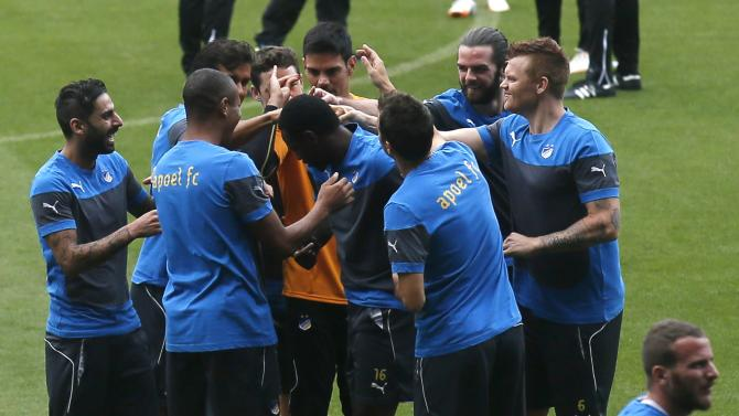 Apoel Nicosia's players joke during a training session at Camp Nou stadium in Barcelona