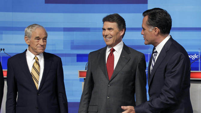Republican presidential candidate's Rep. Ron Paul, R-Texas, left, Texas Gov. Rick Perry, center, and former Massachusetts Gov. Mitt Romney, greet each other prior to a debate Thursday, Sept. 22, 2011, in Orlando, Fla. (AP Photo/John Raoux)