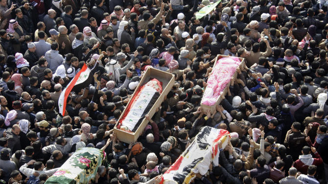 Mourners chant slogans against Iraq's Shiite-led government during a mass funeral in Fallujah, 40 miles (65 kilometers) west of Baghdad, Iraq, Saturday, Jan. 26, 2013. Hundreds of Iraqi protesters have gathered in Fallujah for the funeral of six protesters killed during shooting by army troops a day earlier. (AP Photo/ Khalid Mohammed)