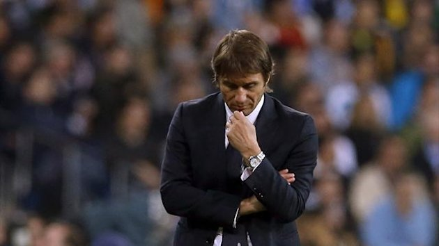 Juventus' coach Antonio Conte reacts during their Champions League match against Real Madrid at Santiago Bernabeu stadium in Madrid October 23, 2013
