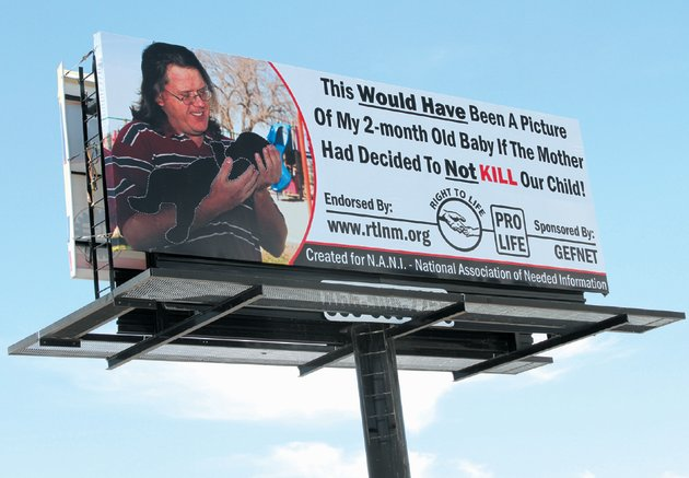 "(J.R. Oppenheim/Alamogordo Daily News) An anti-abortion billboard is shown along White Sands Boulevard near First Street in Alamogordo, N.M. The billboard was paid for by Alamogordo resident Greg Fultz. The billboard depicts a man holding a cutout in the shape of an infant child with the phrase ""This would have been a picture of my 2-month old-baby if the mother decided to not kill our child!"""