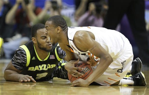 No. 14 Oklahoma State holds off Baylor in Big 12