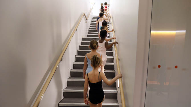 Young dancers make their way into the studio during an audition for six-year old ballet hopefuls at the School of American Ballet, Friday, April 5, 2013 in New York.  (AP Photo/Jason DeCrow)