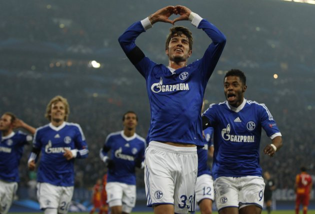 Schalke 04's Neustaedter celebrates a goal against Galatasaray during the Champions League soccer match in Gelsenkirchen