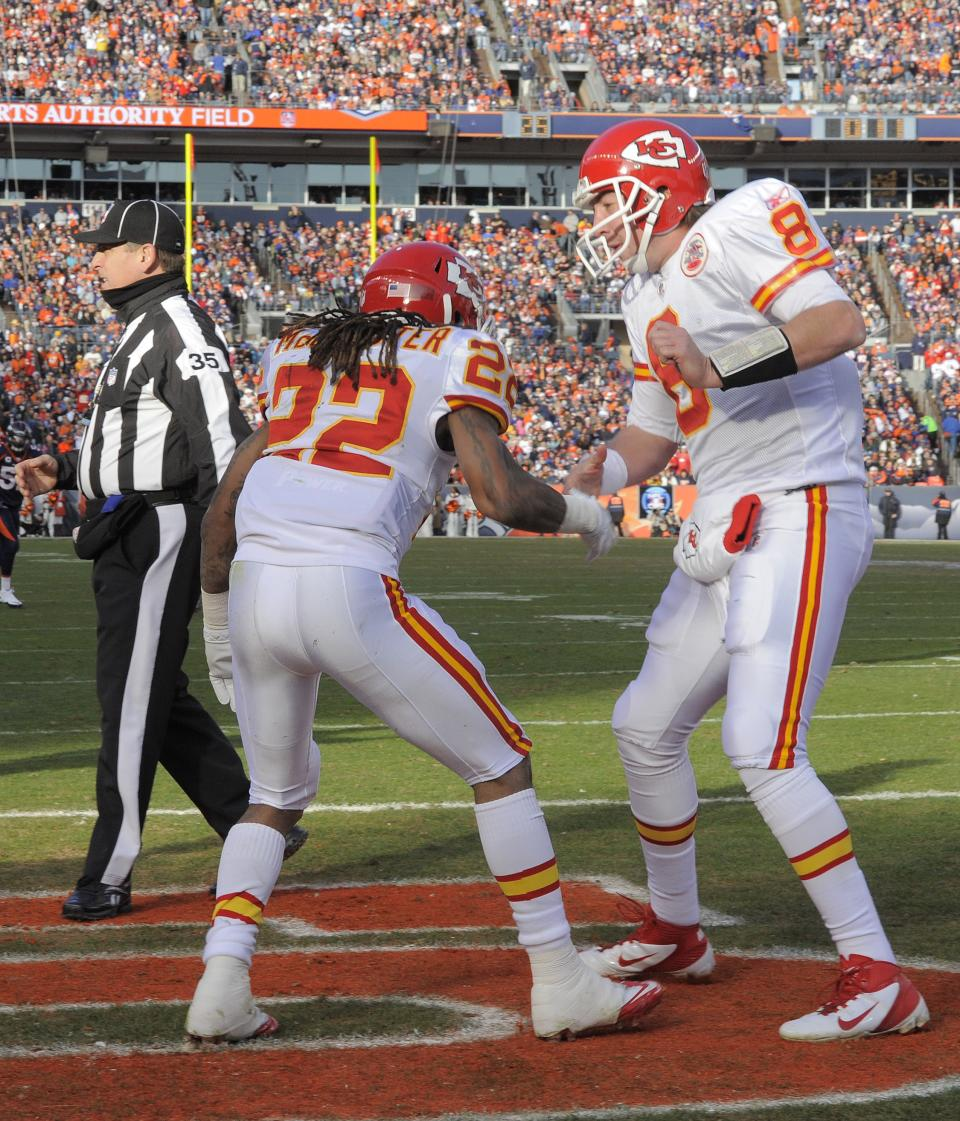 Kansas City Chiefs quarterback Kyle Orton (8) celebrates with running back Dexter McCluster (22) after McCluster scored a touchdown against the Denver Broncos in the first quarter of an NFL football game, Sunday, Jan. 1, 2012, in Denver.  (AP Photo/Jack Dempsey)