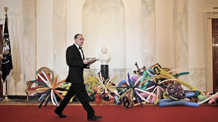 "Party balloons sit on the floor of the Cross Hall of the White House in Washington, Monday, Aug. 20, 2012, in preparations for the Kids' ""State Dinner,"" hosted by first lady Michelle Obama. (AP Photo/Pablo Martinez Monsivais)"