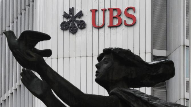 UBS shares fall as legal costs threaten profit