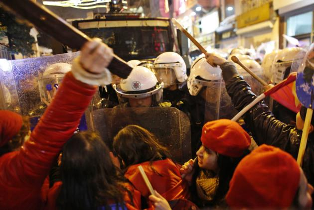 Activists for women's rights scuffle with riot police during an International Women's Day protest in central Istanbul