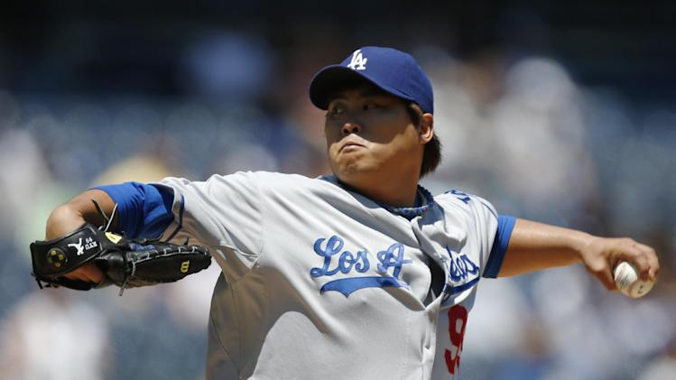 Los Angeles Dodgers starting pitcher Hyun-Jin Ryu winds up in the first inning of a baseball game against the New York Yankees Wednesday, June 19, 2013, in New York. (AP Photo/Kathy Willens)