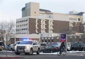 A Washoe County Sheriff vehicle blocks the entrance of the Renown Regional Medical Center during a lockdown in Reno