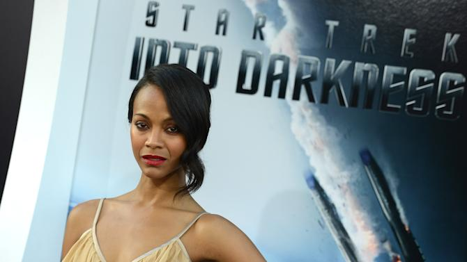 """Zoe Saldana arrives at the LA premiere of """"Star Trek Into Darkness"""" at The Dolby Theater on Tuesday, May 14, 2013 in Los Angeles. (Photo by Jordan Strauss/Invision/AP)"""