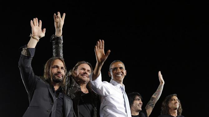 President Barack Obama, center, on stage with members of the Mexican pop rock band Mana, during a campaign event in Desert Pines High School, Sunday, Sept. 30, 2012 in Las Vegas. With Obama are from left to right, Sergio Vallín, Fher Olvera, Juan Calleros, and Alex González. (AP Photo/Pablo Martinez Monsivais)