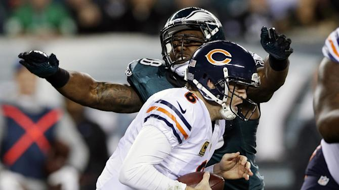 Chicago Bears' Jay Cutler is sacked by Philadelphia Eagles' Trent Cole during the first half of an NFL football game, Sunday, Dec. 22, 2013, in Philadelphia. (AP Photo/Michael Perez)