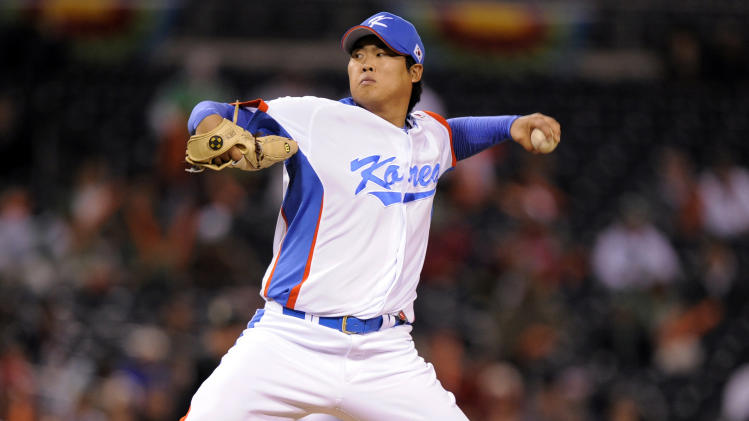FILE - In this March 15, 2009, file photo, South Korea starter Ryu Hyun-jin pitches in the first inning against Mexico during a World Baseball Classic game in San Diego. The Los Angeles Dodgers have bid nearly $26 million for a chance to sign Ryu, the Hanwha Eagles of the Korea Baseball Organization said Saturday, Nov. 10, 2012. (AP Photo/Mark J. Terrill)