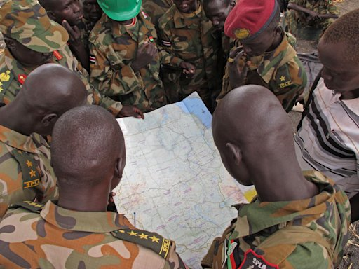 Soldiers from the Sudan People's Liberation Army (SPLA) examine a map at the frontline position in Pana Kuach, Unity State, South Sudan, Friday May 11 2012. In late April, tensions between Sudan and South Sudan erupted into conflict along their poorly defined border. Thousands of SPLA forces have been deployed to Unity State where&lt;br /&gt;&lt;br /&gt;&lt;br /&gt;&lt;br /&gt;&lt;br /&gt;&lt;br /&gt;&lt;br /&gt;&lt;br /&gt;&lt;br /&gt;<br />  the two armies are at a tense stalemate around the state's expansive oil fields. Fighting between the armies lulled in early May after the U.N. Security Council ordered the countries to resume negotiations. (AP Photo/Pete Muller)