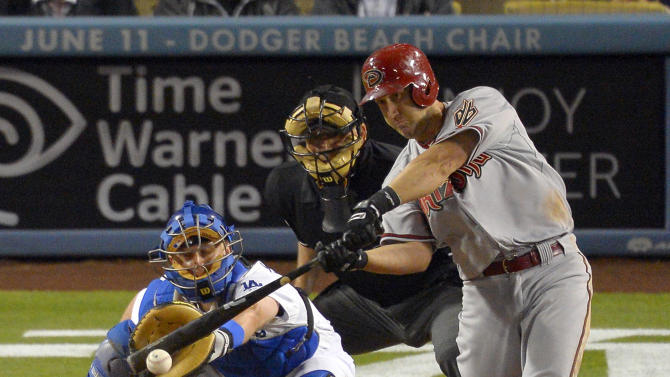 Arizona Diamondbacks' Willie Bloomquist, right, hits a two RBI single as Los Angeles Dodgers catcher Tim Federowicz and home plate umpire Larry Vanover look on during the ninth inning of their baseball game, Monday, June 10, 2013, in Los Angeles.  (AP Photo/Mark J. Terrill)