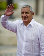 Guatemalan President Otto Perez Molina arrives at the Convention Centre in Cartagena, Colombia to attend the opening of the VI Americas Summit
