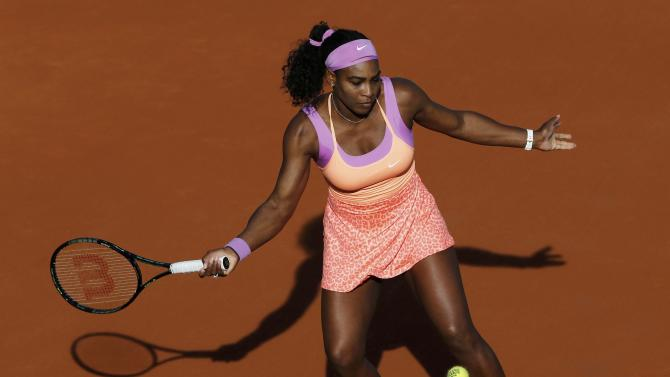 Serena Williams of the U.S. plays a shot to Victoria Azarenka of Belarus during their women's singles match at the French Open tennis tournament at the Roland Garros stadium in Paris