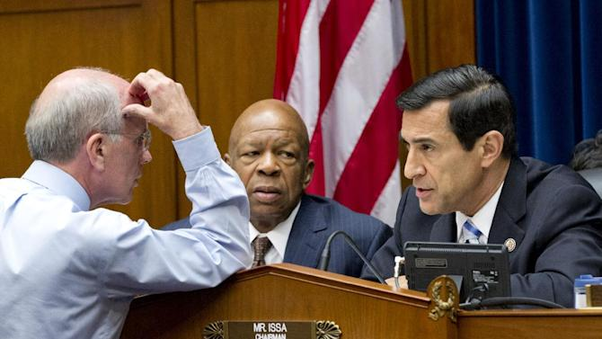 Members of the House Oversight and Government Reform Committee including Rep. Peter Welch, D-Vt., left, confers with Rep. Elijah Cummings, D-Md., center, the ranking member, and Chairman Rep. Darrell Issa, R-Calif., right, on Capitol Hill in Washington, Wednesday, June 20, 2012. (AP Photo/J. Scott Applewhite)