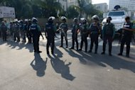 Police stand guard in Dhaka on March 3, 2013 during a nationwide strike called by the Jamaat-e-Islami party over war crime verdicts. Schools and businesses were shut Monday across Bangladesh on the second day of the general strike as huge numbers of police were deployed