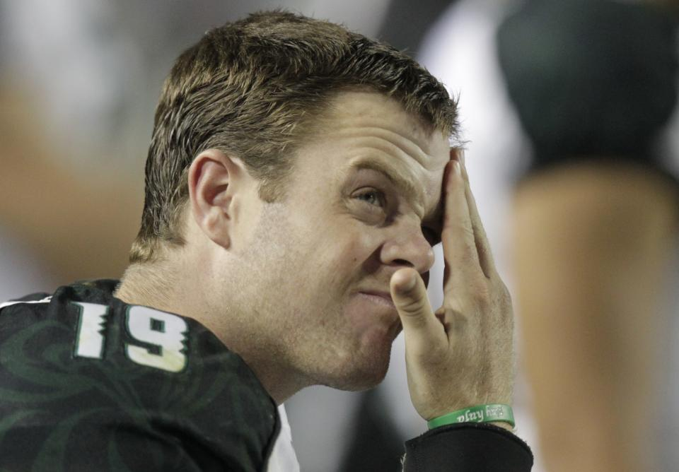 Hawaii quarterback Sean Schroeder rubs his forehead as he looks up at the scoreboard during the fourth quarter of an NCAA college football game Friday, Sept. 28, 2012, in Provo, Utah. BYU defeated Hawaii 47-0. (AP Photo/Rick Bowmer)