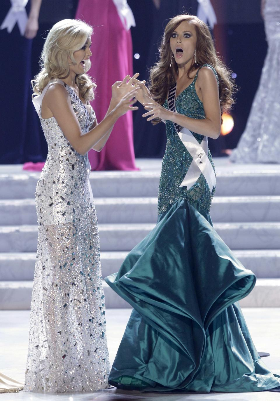 Alyssa Campanella, Miss California, reacts as she is announced as the 2011 Miss USA as Miss Tennessee, Ashley Elizabeth Durham looks on, Sunday, June 19, 2011, in Las Vegas.  (AP Photo/Julie Jacobson)