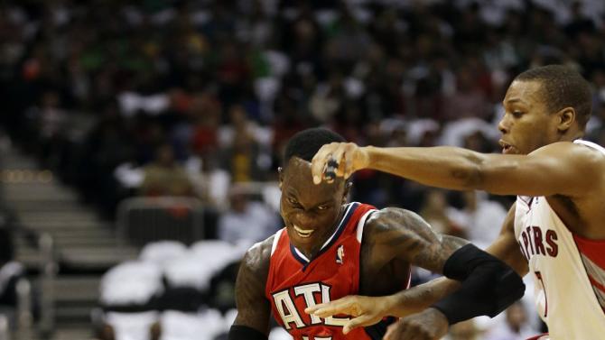 Hawks beat Raptors 102-95; Budenholzer's 1st win