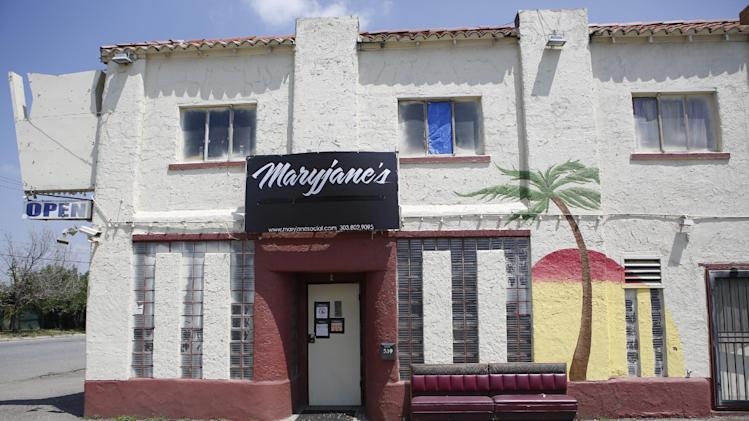 This Wednesday, July 2, 2014 photo shows Maryjane's 420 Shop & Cannabis Social Lounge in Denver. A police raid at the Amsterdam-style cannabis lounge has triggered a debate over where adults can smoke pot in a state that allows recreational marijuana consumption _ but not in public. (AP Photo/Ed Andrieski)