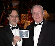 Space writer Andrew Chaikin poses for a photo with Neil Armstrong, the first person to walk on the moon, during a 2002 at an Apollo anniversary event at the Smithsonian National Air & Space Museum. Chaikin is holding photo of the duo taken by A