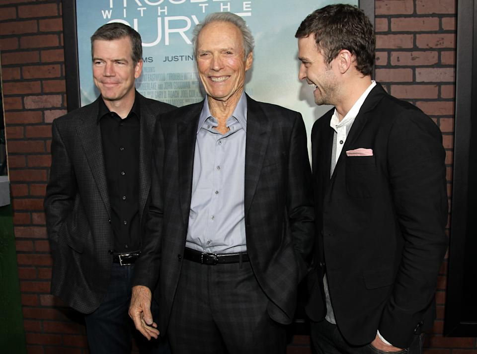 "Cast member Clint Eastwood, center, cast member Justin Timberlake, right, and director Robert Lorenz pose together at the premiere of ""Trouble With the Curve"" at the Westwood Village Theater on Wednesday, Sept. 19, 2012, in Los Angeles. (Photo by Matt Sayles/Invision/AP)"