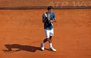 Roger Federer of Switzerland reacts after defeating Lukas Rosol of the Czech Republic during the Monte Carlo Masters in Monaco