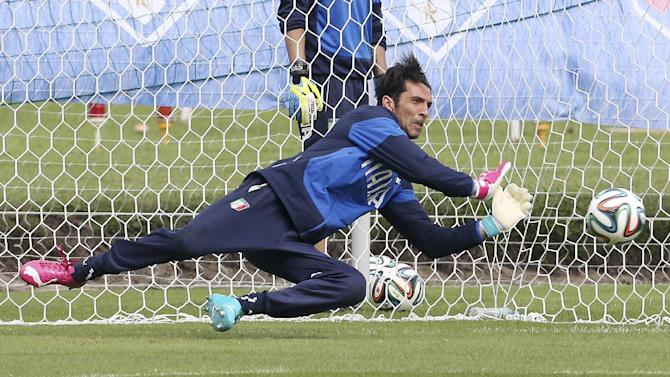 Italy's Gianluigi Buffon tries to stop a ball during a training session in Mangaratiba, Brazil, Wednesday, June 11, 2014. Italy will play in group D of the Brazil 2014 soccer World Cup