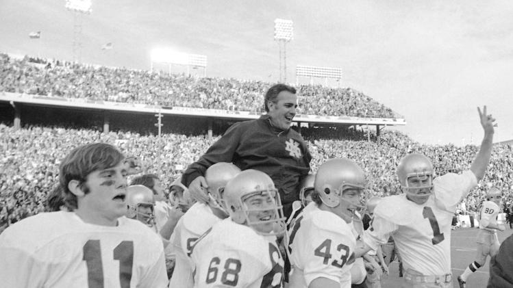 FILE - In this Jan. 1, 1971, file photo, Notre Dame coach Ara Parseghian is carried off the field by his victorious players after the Irish victory over Texas 24-11 in the Cotton Bowl NCAA college football game in Dallas. At a time when college football was generally considered the domain of eastern blue bloods, Notre Dame and Alabama were upstart teams that gave blue collar fans a chance to tweak the elite. About 90 years later, the Fighting Irish and Crimson Tide are the elite - two of college football's signature programs, set to play a national championship next Monday in Miami that could break records for television viewership. (AP Photo/File)