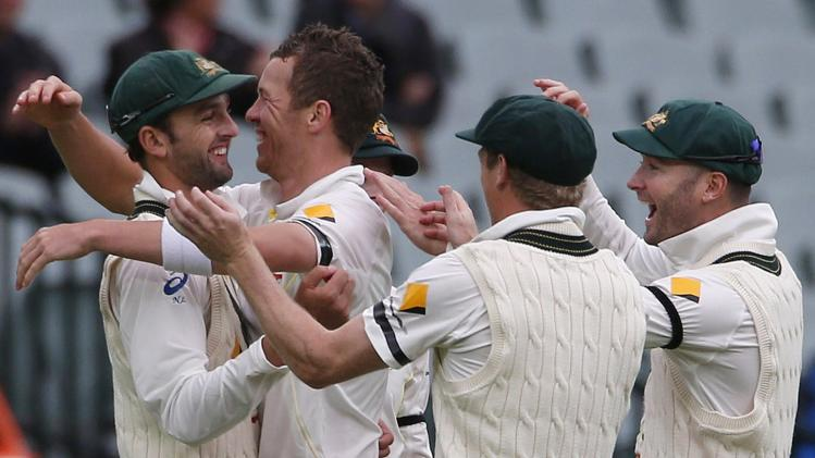 Australia's Lyon celebrates with team mates after taking the wicket of England's Stuart Broad during the fifth day's play in the second Ashes cricket test at the Adelaide Oval